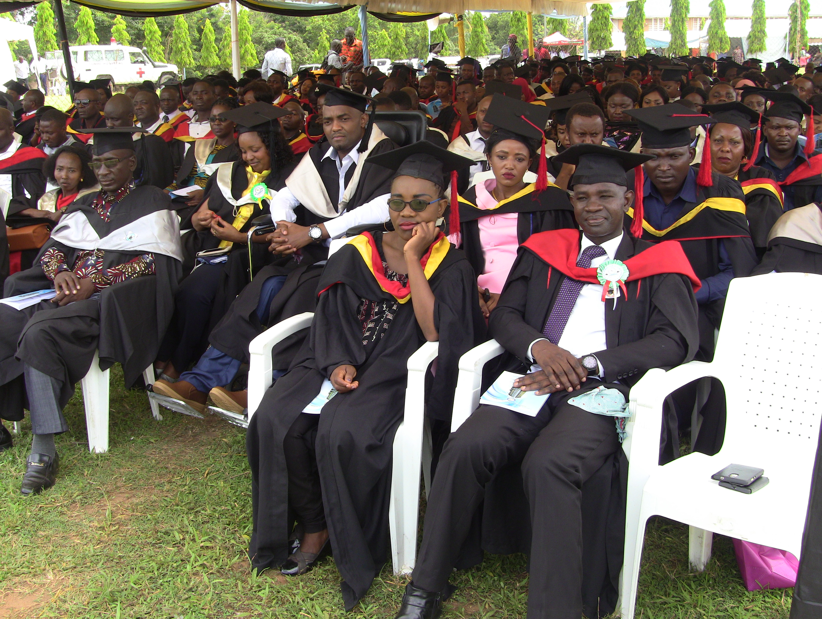 Parts of the graduate students listening to various speeches during the 37th graduation ceremonyof the Open University of Tanzania held on 28th September 2019 at Bungo, Kibaha